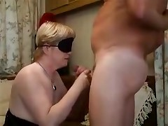 Blonde lady with a blindfold is forced to feel her way to a hard boner previous to putting it in her mouth. The epic blowjob gets a little too hot and that babe need to take a break with a hand job in between the unfathomable throats.