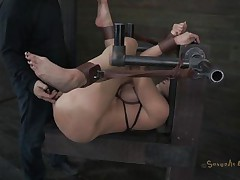 Kelly Divine is tied up with her arse up like a whore. The executor is eager to stick his dick in her but first that chap desires to be sure that Kelly is all soaked and ready for cock. That chap fingers her so mean that that babe makes herself soaking soaked and then that chap starts drilling her. Do you think that chap will cum in her pussy?