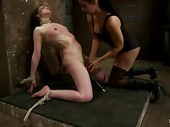 This is hawt and only gets better, a dominating milf wearing stockings and sexy clothing is showing a younger gal who's the boss. She ties her with rope and as the rope goes throughout those her pussy lips, a weight at the end of the rope makes things more interesting. The chick is suffocated also and probably she enjoys it a lot!