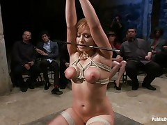 Lea is on her knees, tied up and fucked in the mouth. The public is watching her with attention and surely they will applaud her, that babe is giving her best to make the show interesting and that guy inserts his big hard cock deep in her mouth, making her gag a bit. Look at her, will that babe receive a big load?