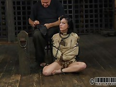 Sexy brunette Elise is all bound up and shackled and sits obedient on the floor near to her executor who puts a mask on her face. This guy explains this s&m technique and what this babe is supposed to do. The bitch enjoys being the center of attention and waits for her bondage treatment. Wanna watch what happens to her?