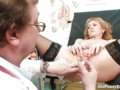 Older blonde Nora is a floozy with big boobs and big hairless vagina that is examined by a gynecologist. The doctor uses a metal speculum and gapes her bawdy cleft so we can see inside it. This floozy seems to be healthy and her bawdy cleft is now willing for a hard fuck.