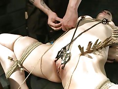 Katharine Cane is a breasty brunette milf desperately in need for punishment. Watch how Soma Snakeoil and her male ally give her what this honey wants. The sexy red haired honey and her assist are putting clothespins all over her body, making her scream with pleasure and pain while rubbing her pussy with a large vibrator.
