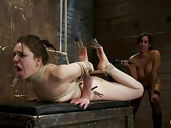 Brunette hair honey with pretty face and sexy ass is getting whipped by this playgirl with big tits. She has laundry pliers on her toes and tongue and it looks like that babe enjoys the pain. After whipping her that babe starts fisting her oiled cunt 1st with one hand and then with both of them. Her snatch barely takes it but that babe has to endure her treatment because she's tied up actually good. When that babe finishes using her hands and a vibrator to fuck that pussy, the busty playgirl starts to untie her, what's going to happen next?