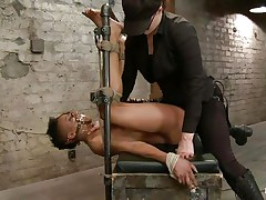 With her feet fastened up and metal clamps all over her body the ebony slut endures a harsh punishment. This femdom-goddess knows what he's doing and gives her both pang and pleasure. She can't even scream as her throat is folded with scotch tape. Look at that shaved cunt and how deep she's rubbing it with the vibrator.