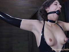 Dark brown Marina wearing a black latex suit and having a large black ball gagging her mouth is about to be punished by her executor. The man starts with her zeppelins and uses very large suckers to torture 'em and when Marine's nipples are hard he ties 'em with rubber bands. Appears to be that babe will stay there for a long time