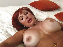 Her years of experience in fucking have a lot to say. Check out this gorgeous redhead milf and how lustfully this babe sucks and bonks cock. Damn the bitch knows how to gulp a ramrod and when this babe goes on top and rides this stud we can clearly watch her pussy lips spreading. Yes this milf needs some jizz deep inside her