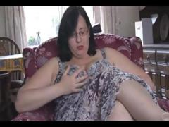 Fat mature brunette with massive scoops and ass sticks dildo in her pussy