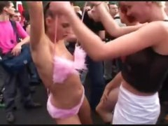 Chicks dance in nature's garb in a big crowd outdoors
