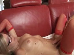 Heavily tattoo blond teen sits gently on rod