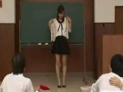 Japanese teacher reluctantly strips in nature's garb in front of students
