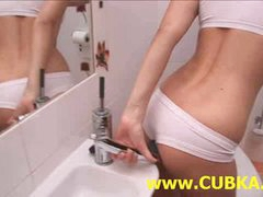 Charming golden-haired dildoing in toilet