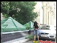 Slut shows her peeing wet crack near a car
