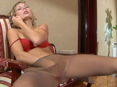 Heated hotty strips to her silky hose and rubs her pink talking on the phone
