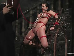 Mia Bangg is bound and gagged in the dungeon where her torturer sprays her nipple-clamped tits. He asks if this babe wants to get screwed and this babe does, but first he gives her a little greater amount ache by pulling tight the rope that splits her pussy lips and smacks her pussy before using a dildo on her.