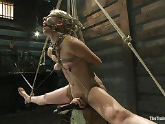 Chastity Lynn is a blonde milf who enjoys being tied up with ropes. She likes when that babe is not able to move her hands and feet freely. As that babe stands helpless with a ball gag in her face hole and a rope blindfold on her eyes, a friend is giving her a big time pleasure, rubbing her cunt with a vibrator.