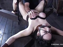 This brunette is milky white and her cum-hole is so constricted and perfect that they had to gape it and reveal the inside of it. Have a fun watching this bitch in a uncomfortable position as her large soft love muffins are squeezed and sucked and her mouth gagged. Four clamps are added on her adorable cum-hole to gape it for our sight