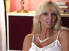 mature whores from usa are known to be sexy and naughty. Here we have Tia Gunn, a blonde bitch with giant boobs and a lewd face that can give any guy an erection. This babe takes out her melons after a short talk and taunts us with 'em by squeezing 'em hard. Do u think this babe deserves a cock between her breasts and some semen?