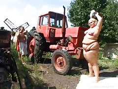 Melinda is so much woman she needs 2 men to fuck her. Tibor and Gabor lift up her plump folds and widen her ass cheeks. The both suck on her huge melons outside by the tractor. The rubs every part of her big plump beautiful body.