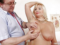 This blonde floozy is completely naked at the doctor. The doctor begins examining her large breasts with large and sexy nipples. After that that guy takes her pulse. The mature women is sitting on the daybed now with her large a-hole at the doctor. That guy start inspects her a-hole and large shaved vagina from behind.