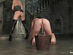 She has tied his balls with a rope and this babe has tied the other end of the rope to a bucket. It means that he cannot move without pain in his balls. This guy is commanding her to engulf her love tunnel and lick her ass. Then this babe makes him lie on the table as this babe squeezes his balls and hurt him as badly as this babe can.