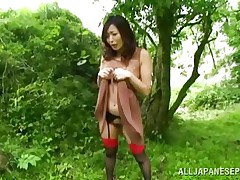 Nature loving Nippon cutie is receiving her dose of wilderness! This cute bitch has her hands tied on a tree branch and gets roughly fucked from behind. Her moans and screams won't help her because there's nobody around. Look at that sweet snatch being rubbed with a dildo and then fucked hard.