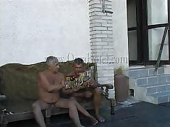 These two old farts where looking in a porn magazine when granny Heidrun caught them. As long they were all there they've began fucking and formed a threesome. The granny was naked by the old guys and they've started to grope her boobs and massage her saggy cunt. Will they fill her with semen?
