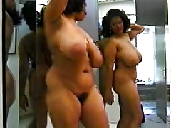 Darksome woman with excellent body dancing in mirror
