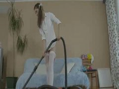 Cute houswife with vacuum cleaner