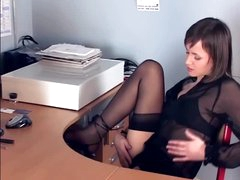 Brunette hair masturbates in sheer stockings and heels