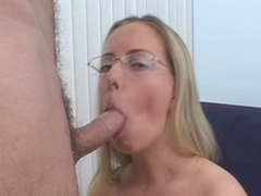 Blonde in glasses sucks pecker and gets fur pie pounded