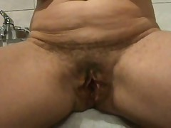 Ever wonder what an old hairy pussy looks like widen wide open?  Well now u don't have to wonder as this hottie shows her loose hanging lips pulled apart for everybody to see inside her cunt.  If you're into big loose pussy lips, this one is for u as this clip is all pussy, all open. The only thing missing is he asshole.