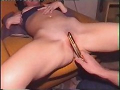Charming wife acquires her bald slit filled with golden sex-toy, which her spouse pokes into her dripping twat.