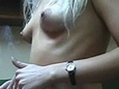 Lecherous blond sweetheart with petite sticking tits walks naked in her room filmed by her boy-friend with dilettante cam in his hands. This guy doesn't like her smokin' but really enjoys her hawt nude body shyly covered by Recent Year tree decoration :)