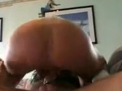 This gal is taking a strap-on sextoy in her ass. Her hubby fills her wazoo with it hard. Then she sucks his ramrod and finishes with his wang in her pussy