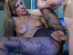 Oversexed gal in flower pattern hose getting a leg over in the office