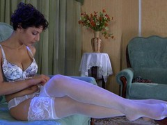 Bobbed darksome brown hair lovingly smoothing her luscious white lace top stockings
