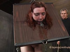 She's horrified of what's about to happen and who can blame the bitch? Take a look at her, how that playgirl is secured in that bondage device and has a device in her mouth that keeps it opened. The executor doesn't wastes time and spanks her white ass in advance of fucking her mouth and hairless muff with a big dildo.