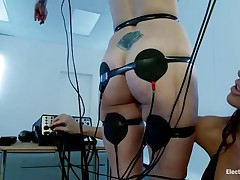 A sexy redhead with valuable boobs and a bald love tunnel is bound in front of this naughty brunette. Her body is covered with electrodes and she's getting some stimulation throughout them and likewise from that sextoy the dark brown is using to rub her clitoris. Look at her moaning and receiving all the socking pleasures she wants.