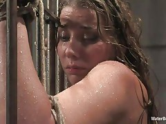 After that guy bound her on the bars and gave her body a good showering the executor thinks that it's time for a baths so that guy chained her and putted her sexy body completely beneath water allowing her to breath only through a tube. She 's bound and the dude has complete control over her so why not finger her love tunnel too.