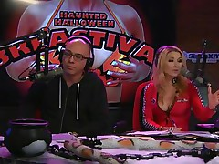 On Playboy Radio's Morning Show, three dressed-up hotties are racing against the clock to make a ghost costume. The in-studio guest is acting as a judge as well but the cuties are having trouble. The male host goes to help and the winner is the short cutie who cut out breast holes in her sheet.