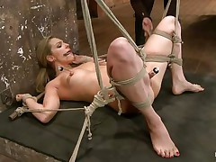 Take a look how hard her pussy is sucked! The golden-haired babe is about to receive a hard punishment from her experienced mistress. She hangs her upside down, removes the sucker and oils her pussy. After that the mistress fingers deeply the blonde's fur pie and makes her shriek insanely and almost to cum!