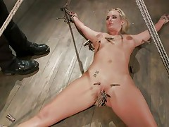 Slutty blonde Marie has her body all tied up and her legs widen on the floor. Her horny executor enjoys touching her juicy shaved love tunnel and torturing it at the same time with a lot of laundry pliers. This man tickles it, but doesn`t let her cum also soon. This man 1st wants to bring a sex tool in the scene. So hot!