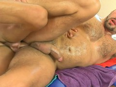 Shaggy guy receives a lusty anal spooning from masseur