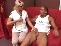 Nurse helps the muscular man acquire laid