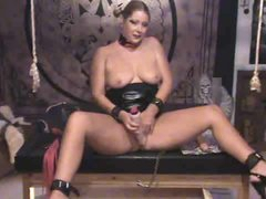 In her personal dungeon toying her slit