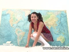 Cute latina masturbates in front of a map