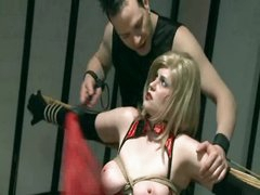Fastened Milf Spanked And Toyed