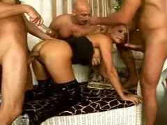 Gangbang blond in latex boots fuck and facial