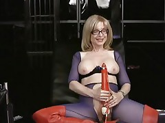 Nina Hartley likes tormenting her soaked wet slot
